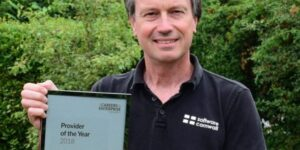 Photo of Robert Wiltshire holding an award