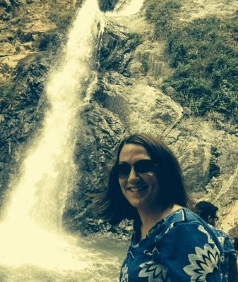 Holly Patton in front of a waterfall